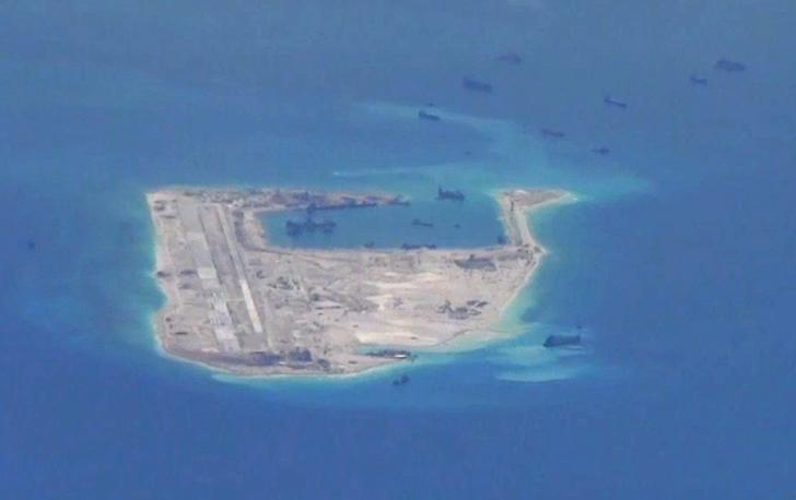 Chinese dredging vessels are purportedly seen in the waters around Fiery Cross Reef in the disputed Spratly Islands in this still image from video taken by a P-8A Poseidon surveillance aircraft May 21, 2015. REUTERS/U.S. Navy/Handout via Reuters