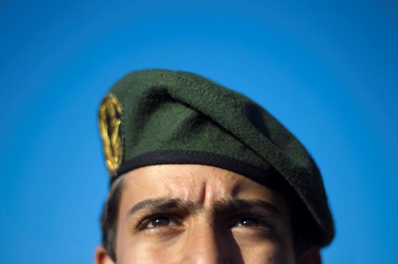 A member of Iran's Revolutionary guard stands at attention during an anti-U.S. ceremony in Azadi (freedom) Square in Tehran April 25, 2010.REUTERS/Morteza Nikoubazl