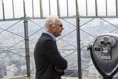 Soccer legend Franz Beckenbauer pauses to look out on the city on top of the Empire State Building during an event to celebrate the start of the New York Cosmos 2015 season, in New York April 17, 2015. REUTERS/Lucas Jackson