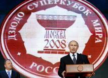 File picture of Vladimir Putin delivering a speech next to the then European Judo Union President Marius Vizer (L) during an opening ceremony of the Judo Super World Cup in Moscow May 24, 2008.  REUTERS/Denis Sinyakov
