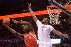 Mar 22, 2016; Oklahoma City, OK, USA; Houston Rockets forward Clint Capela (15) shoots the ball over Oklahoma City Thunder forward Serge Ibaka (9) during the second quarter at Chesapeake Energy Arena. Mandatory Credit: Mark D. Smith-USA TODAY Sports
