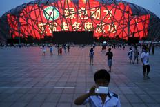 A message of congratulation is projected onto the Bird's Nest Olympic stadium as people celebrate after Beijing was chosen to host the 2022 Winter Olympics in Beijing July 31, 2015.  REUTERS/Damir Sagolj