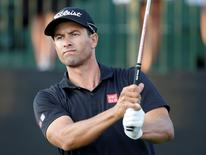 Mar 19, 2016; Orlando, FL, USA;  Adam Scott of Australia hits his drive on the first tee during the third round of the Arnold Palmer Invitational presented by Master Card at the Bay Hill Club and Lodge . Mandatory Credit: Reinhold Matay-USA TODAY Sports