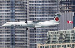 An Air Canada Express flight descends to land at the Billy Bishop Toronto City Airport, also known as the Toronto Island Airport, in Toronto, May 12, 2015. REUTERS/Mark Blinch
