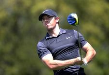 Mar 26, 2016; Austin, TX, USA; Rory McIlroy of Northern Ireland tees off against Chris Kirk of the United States in round five of the World Golf Championship-Dell Match Play at the Austin Country Club. McIlroy defeated Kirk. Mandatory Credit: Erich Schlegel-USA TODAY Sports