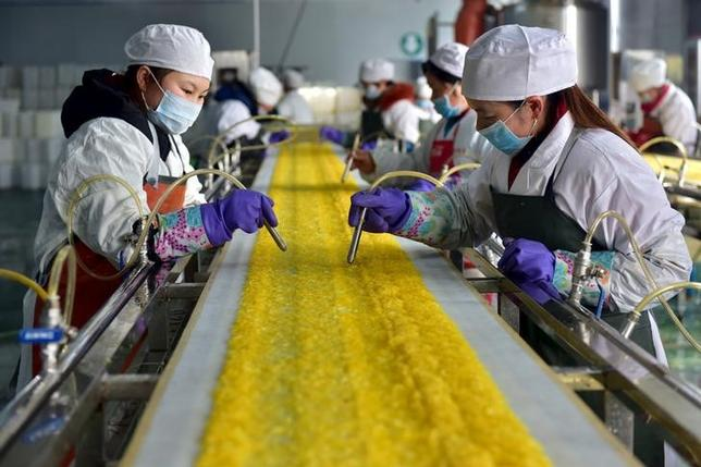 Employees work at a food processing factory in Yichang, Hubei province, January 17, 2016. Picture taken January 17. REUTERS/Stringer