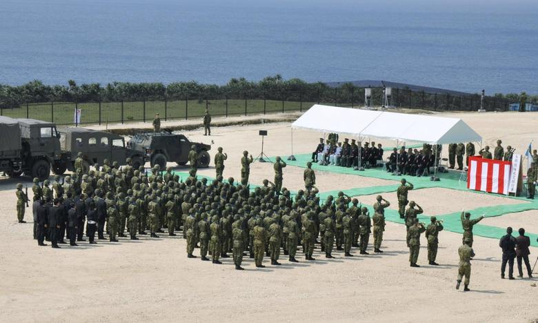 Members of Japan's Self Defence Force hold an opening ceremony of a new military base on the island of Yonaguni in the Okinawa prefecture, March 28, 2016. REUTERS/Kyodo