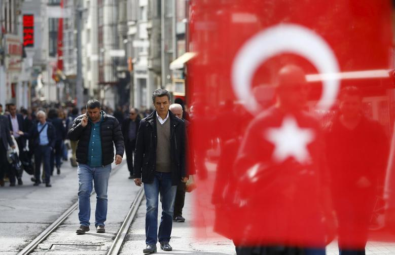 People stroll at Istiklal street, a major shopping and tourist district, in central Istanbul, Turkey March 22, 2016. REUTERS/Osman Orsal