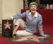 Award-winning actress Patty Duke poses for photographers following an unveiling ceremony, honoring her with the 2,260th star on the Hollywood Walk of Fame in Los Angeles, California August, 17, 2004.  REUTERS/Jim Ruymen  JR/GN