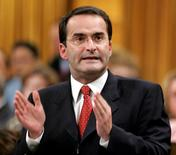 Former Canadian Transport Minister Jean Lapierre stands to speak in the House of Commons on Parliament Hill in Ottawa in this file photo taken November 16, 2005.   REUTERS/Chris Wattie/Files