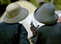 File photo of elderly ladies wearing sunhats chatting in Victory Square in dowtown Vancouver, July 22, 2003. REUTERS/Andy Clark