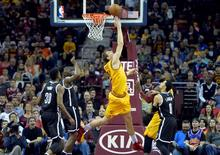 Mar 31, 2016; Cleveland, OH, USA; Cleveland Cavaliers center Timofey Mozgov (20) makes a reverse layup in the second quarter against the Brooklyn Nets at Quicken Loans Arena. David Richard-USA TODAY Sports