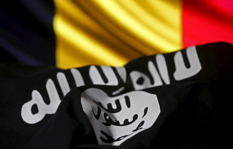 Islamic State flag is seen in front of a Belgian flag in this illustration taken March 22, 2016. REUTERS/Dado Ruvic/Illustration