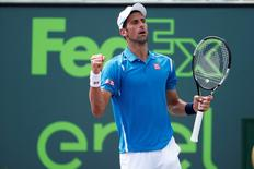 Apr 1, 2016; Key Biscayne, FL, USA; Novak Djokovic celebrates after match point against David Goffin (not pictured) during a men's singles semifinal on day twelve of the Miami Open at Crandon Park Tennis Center. Mandatory Credit: Geoff Burke-USA TODAY Sports