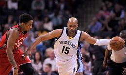 Apr 1, 2016; Memphis, TN, USA; Memphis Grizzlies guard Vince Carter (15) handles the ball against Toronto Raptors guard DeMar DeRozan (10) during the first half at FedExForum. Mandatory Credit: Justin Ford-USA TODAY Sports