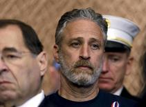 Comedian/director Jon Stewart (C) listens during at an event to urge U.S. lawmakers to re-authorize the Zadroga Bill at the U.S. Capitol in Washington September 16, 2015. REUTERS/Gary Cameron
