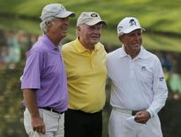 U.S. golfing great Jack Nicklaus poses for a picture with compatriot Ben Crenshaw (L) and Gary Player of South Africa (R) after playing in the par 3 event held ahead of the 2015 Masters at Augusta National Golf Course in Augusta, Georgia April 8, 2015.  REUTERS/Brian Snyder/Files