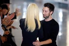 Italian designer Donatella Versace (L) greets designer Anthony Vaccarello at the end of his Autumn/Winter 2015/2016 women's ready-to-wear collection show during Paris Fashion Week March 3, 2015. Picture taken March 3, 2015.  REUTERS/Charles Platiau