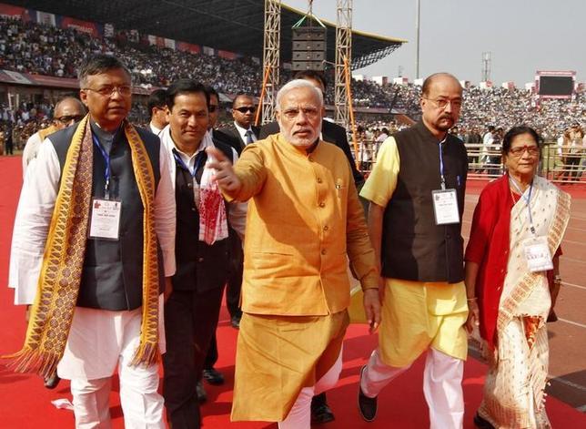 Prime Minister Narendra Modi (C) gestures as he arrives to address the Bharatiya Janata Party (BJP) workers meeting in Guwahati, Assam, November 30, 2014. REUTERS/Utpal Baruah/Files