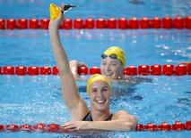 Bronte Campbell of Australia celebrates in front of her fourth placed sister Cate Campbell (rear) after winning the women's 50m freestyle final at the Aquatics World Championships in Kazan, Russia, August 9, 2015.     REUTERS/Michael Dalder