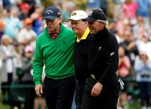 Apr 6, 2016; Augusta, GA, USA; From left Tom Watson , Jack Nicklaus and Gary Player walk off the 9th green during the Par 3 Contest prior to the 2016 The Masters golf tournament at Augusta National Golf Club. Mandatory Credit: Rob Schumacher-USA TODAY Sports
