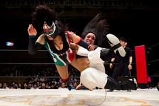 Wrestlers Kris Wolf and Starfire fight during their Stardom professional wrestling show at Korakuen Hall in Tokyo, Japan, July 26, 2015.  REUTERS/Thomas Peter
