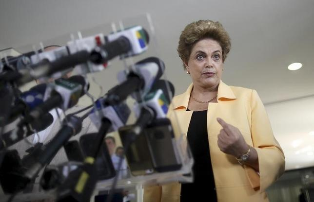 President Dilma Rousseff addresses a news conference after visiting the new Embraer KC 390 military transport aircraft in Brasilia, Brazil April 5, 2016. REUTERS/Adriano Machado - RTSDP79