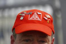 A member of German metal workers union IG Metall (IGM) wears an IGM cap during a walk out  from the day shift in a warning strike at the Mercedes Benz factory in Sindelfingen January 29, 2015.  REUTERS/Kai Pfaffenbach