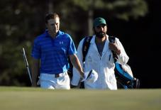 Apr 10, 2016; Augusta, GA, USA; Jordan Spieth walks to the 18th green with caddie Michael Greller during the final round of the 2016 The Masters golf tournament at Augusta National Golf Club. Michael Madrid-USA TODAY Sports