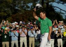 Apr 10, 2016; Augusta, GA, USA; Danny Willett waves to the crowd after completing the 18th hole during the final round of the 2016 The Masters golf tournament at Augusta National Golf Club. Rob Schumacher-USA TODAY Sports