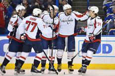 Apr 9, 2016; St. Louis, MO, USA; Washington Capitals left wing Alex Ovechkin (8) celebrates with teammates after scoring a goal against the St. Louis Blues during the first period at Scottrade Center. Mandatory Credit: Jasen Vinlove-USA TODAY Sports