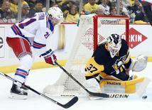 Apr 13, 2016; Pittsburgh, PA, USA; Pittsburgh Penguins goalie Jeff Zatkoff (37) makes a save against New York Rangers center Derek Stepan (21) during the first period in game one of the first round of the 2016 Stanley Cup Playoffs at the CONSOL Energy Center. Charles LeClaire-USA TODAY Sports