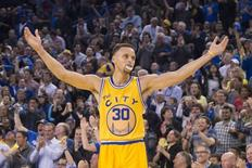 Golden State Warriors guard Stephen Curry celebrates against the Washington Wizards, March 29, 2016. Mandatory Credit: Kyle Terada-USA TODAY Sports