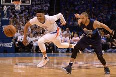 Apr 16, 2016; Oklahoma City, OK, USA; Dallas Mavericks guard Devin Harris (34) fouls Oklahoma City Thunder guard Russell Westbrook (0) during the third quarter in game one of their first round NBA Playoffs series at Chesapeake Energy Arena. Mandatory Credit: Mark D. Smith-USA TODAY Sports