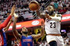 Cleveland Cavaliers forward LeBron James (23) passes the ball as Detroit Pistons center Andre Drummond (0) defends during the second half in game one of the first round of the NBA Playoffs at Quicken Loans Arena. The Cavs beat the Pistons 106-101. Mandatory Credit: Ken Blaze-USA TODAY Sports