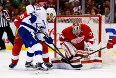 Apr 17, 2016; Detroit, MI, USA; Detroit Red Wings goalie Petr Mrazek (34) makes the save against Tampa Bay Lightning center Valtteri Filppula (51) during the first period in game three of the first round of the 2016 Stanley Cup Playoffs at Joe Louis Arena. Rick Osentoski-USA TODAY Sports