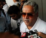 Force India team principal Vijay Mallya talks to the media in the paddock during the third practice session of the Indian F1 Grand Prix at the Buddh International Circuit in Greater Noida, on the outskirts of New Delhi, October 27, 2012. REUTERS/Ahmad Masood