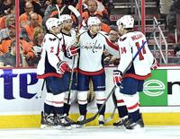 Apr 18, 2016; Philadelphia, PA, USA; Washington Capitals center Evgeny Kuznetsov (92) celebrates his goal with teammates against the Philadelphia Flyers during the third period in game three of the first round of the 2016 Stanley Cup Playoffs at Wells Fargo Center. The Capitals defeated the Flyers, 6-1. Eric Hartline-USA TODAY Sports