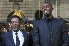 "(L-R) Former soccer player Pele and Olympic printer Usain Bolt pose during a ribbon cutting ceremony to celebrate the opening of the flagship ""Hublot"" store on Fifth Avenue in the Manhattan borough of New York, U.S., April 19, 2016.  REUTERS/Andrew Kelly"