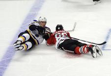 St. Louis Blues center Jori Lehtera (12) and Chicago Blackhawks left wing Teuvo Teravainen (86) fall to the ice during the second period in game four of the first round of the 2016 Stanley Cup Playoffs at United Center. Mandatory Credit: David Banks-USA TODAY Sports