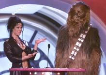 "Professional wrestler Chyna (L) and Star Wars character ""Chewbacca"" present an award at the Nickelodeon Kids' Choice Awards, April 21, 2001 in Santa Monica. Reuters/Files"