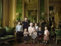 Britain's Queen Elizabeth II poses with her five great-grandchildren and her two youngest grandchildren in the Green Drawing Room, part of Windsor Castle's semi-State apartments. The children are: James, Viscount Severn (left), 8, and Lady Louise (second left), 12, the children of The Earl and Countess of Wessex;  Mia Tindall (holding The Queen's handbag), the two year-old-daughter of Zara and Mike Tindall; Savannah (third right), 5, and Isla Phillips (right), 3, daughters of The Queen's eldest grandson Peter Phillips and his wife Autumn; Prince George (second right), 2, and in The Queen's arms and in the tradition of Royal portraiture, the youngest great-grandchild, Princess Charlotte (11 months), children of The Duke and Duchess of Cambridge, in this official photograph, released by Buckingham Palace to mark her 90th birthday April 20, 2016 Credit must read: c2016 Annie Leibovitz/Handout