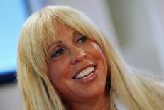 Lynn Tilton, chief executive officer of private equity firm Patriarch Partners, speaks at the 2009 Reuters Restructuring Summit in New York September 29, 2009. Tilton is in the early stages of launching a bank holding company that would target middle market bank lending.  REUTERS/Mike Segar