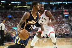Indiana Pacers forward Paul George (13) drives against Toronto Raptors forward DeMarre Carroll (5) during the second quarter in game five of the first round of the 2016 NBA Playoffs at Air Canada Centre. Mandatory Credit: Nick Turchiaro-USA TODAY Sports