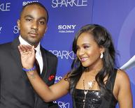 Bobbi Kristina Brown, daughter of the late singer Whitney Houston,  arrives with boyfriend Nick Gordon at the premiere of the new film 'Sparkle' in Hollywood August 16, 2012. REUTERS/Fred Prouser