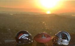 Feb 6, 2016; San Francisco, CA, USA; General view of Carolina Panthers and Denver Broncos helmets and NFL Wilson Duke Super Bowl 50 football overlooking the downtown San Francisco skyline at sunrise. Mandatory Credit: Kirby Lee-USA TODAY Sports