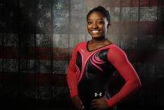Gymnast Simone Biles poses for a portrait at the U.S. Olympic Committee Media Summit in Beverly Hills, Los Angeles, California March 7, 2016. REUTERS/Lucy Nicholson