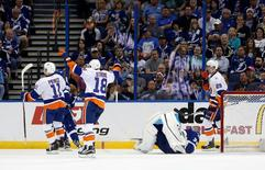 Apr 27, 2016; Tampa, FL, USA; Tampa Bay Lightning goalie Ben Bishop (30) falls to the ice as New York Islanders center Shane Prince (11) scores a goal during the first period in game one of the second round of the 2016 Stanley Cup Playoffs at Amalie Arena. Kim Klement-USA TODAY Sports