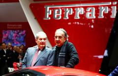Sergio Marchionne and Amedeo Felisa (L) pose with the new Ferrari 488 GTB during the first press day ahead of the 85th International Motor Show in Geneva March 3, 2015. REUTERS/Arnd Wiegmann