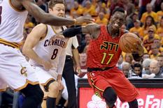 Atlanta Hawks guard Dennis Schroder (17) drives past Cleveland Cavaliers guard Matthew Dellavedova (8) during the second half in game one of the second round of the NBA Playoffs at Quicken Loans Arena. The Cavs won 104-93. Mandatory Credit: Ken Blaze-USA TODAY Sports